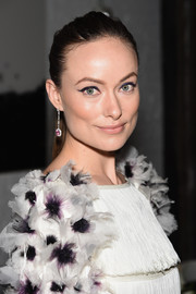 Olivia Wilde glammed up her simple hairstyle with a lovely pair of dangling gemstone earrings.