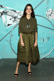 Leandra Medine stayed cozy in an army-green V-neck sweater at the Tiffany Blue Book Collection celebration.
