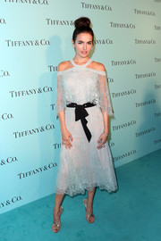 Camilla Belle enchanted in a pale blue cold-shoulder lace dress by Monique Lhuillier at the unveiling of Tiffany & Co.'s renovated Beverly Hills store.