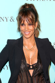 Halle Berry adorned her decollete outfit with layered chain necklaces by Tiffany & Co. when she attended the unveiling of the jeweler's renovated Beverly Hills store.