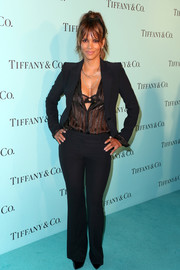 Halle Berry hovered between masculine and sexy in a black Alexander McQueen suit teamed with a plunging, sheer blouse at the unveiling of Tiffany & Co.'s renovated Beverly Hills store.