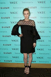 Gracie Otto rocked a modern style black dress with honeycomb mesh neckline and puffed sleeves.