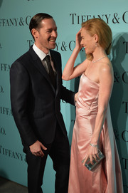 Kate Bosworth attended the Tiffany Blue Book debut sporting an very elegant mirrored Rauwolf clutch and strapless gown combo.