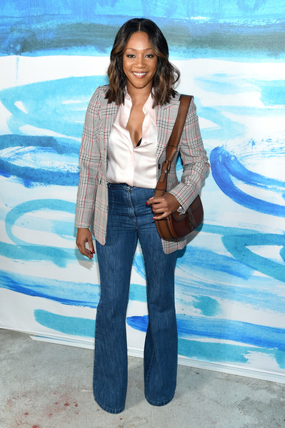 Tiffany Haddish Flare Jeans [michael kors collection spring 2019 runway show,jeans,clothing,denim,fashion,textile,photo shoot,fun,outerwear,photography,long hair,tiffany haddish,front row,new york city,pier 17]