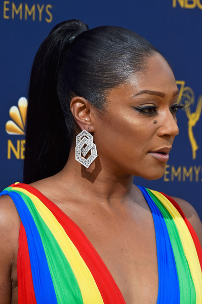 Tiffany Haddish Ponytail [hair,hairstyle,electric blue,black hair,neck,croydon facelift,ear,arrivals,tiffany haddish,emmy awards,70th emmy awards,jewelry detail,microsoft theater,los angeles,california]