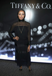 Kat Graham went for goth elegance in a high-neck black evening dress at the Tiffany HardWear Los Angeles preview.