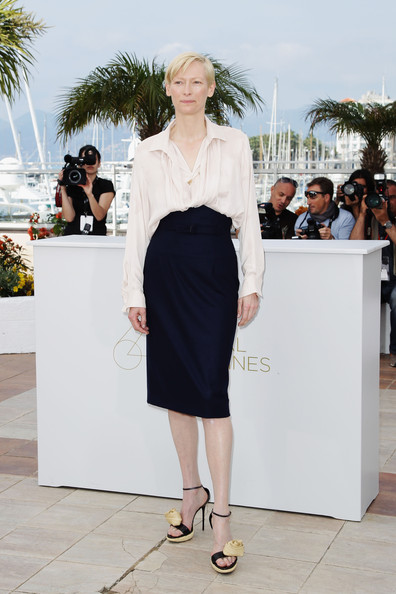 Tilda Swinton Pencil Skirt [we need to talk about kevin photocall,white,clothing,fashion,street fashion,dress,shoulder,footwear,shoe,sandal,haute couture,tilda swintonattends,cannes,france,cannes film festival,photocall,palais des festivals]
