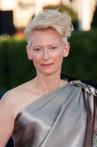 Tilda Swinton Fauxhawk [hair,face,blond,hairstyle,lip,eyebrow,shoulder,beauty,skin,chin,deauville,france,award ceremony,snowpierce premiere - the 39th deauville film festival,closing ceremony,deauville american film festival,tilda swinton]