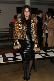 Julia Restoin-Roitfeld completed her edgy outfit with a shiny black pencil skirt.