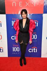 Camila Cabello looked flamboyant in a black and fuchsia rose-sleeve blazer by Alexander McQueen at the Time 100 Next event.