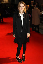 Sairose Ronan covered up her shape in a long black satin evening coat and a crisp white shirt.