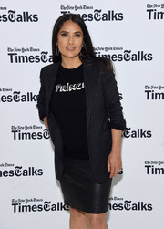 Salma Hayek attended TimesTalks: The Allegory of 'Beatriz at Dinner' wearing a black pinstriped blazer, tee, and leather skirt combo.