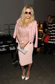 Kesha was both sweet and sexy in an all-pink pencil skirt and sheer lace cami combo at the Timo Weiland fashion show.