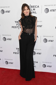 Emily Mortimer paired her top with black wide-leg pants.