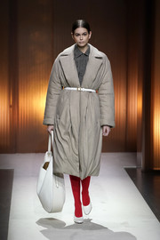 Kaia Gerber looked stylish in a taupe wool coat while walking the Tod's Fall 2020 show.
