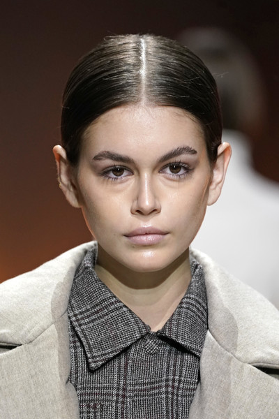 Kaia Gerber walked the Tod's runway wearing a simple center-parted updo.