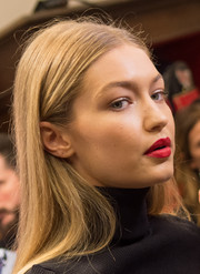 Gigi Hadid made her kissers pop with a swipe of bright red lipstick.