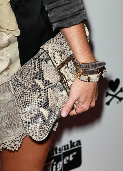 Taryn showed off a slithering snakeskin clutch while hitting a launch party in Hollywood.
