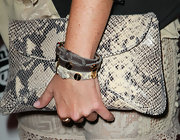 Taryn perfectly paired her snakeskin clutch with matching leather bracelets, complete with gold hardware.