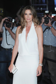 Cindy Crawford matched a white box clutch with a plunging dress for the Tom Ford fashion show.