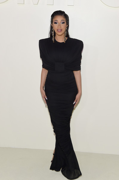 Cardi B showed off her elegant side in a ruched black gown by Tom Ford during the brand's Spring 2019 show.