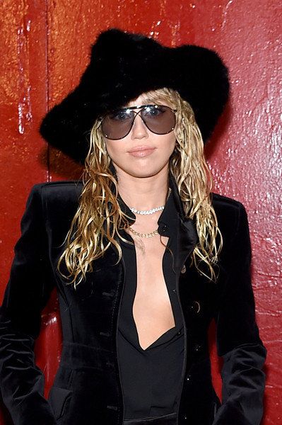Miley Cyrus attended the Tom Ford fashion show wearing a faux-mink hat from the label.