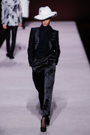 Joan Smalls was classic in a black satin pantsuit while walking the Tom Ford Fall 2019 show.