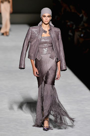 Kaia Gerber showed off a bold-shouldered lilac croc-embossed jacket on the Tom Ford Spring 2019 runway.