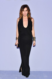 Gina Gershon was sexy and sophisticated in a plunging black halter gown at the Tom Ford fashion show.
