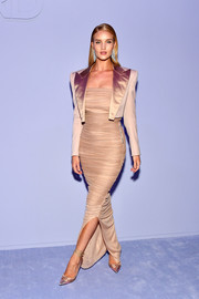 Rosie Huntington-Whiteley added a masculine-chic touch with a satin-lapel cropped jacket, also by Tom Ford.