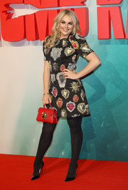 Tallia Storm hit the red carpet wearing a Dolce & Gabbana sacred heart-print dress at the European premiere of 'Tomb Raider.'