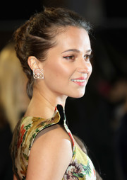 Alicia Vikander adorned her lobes with a pair of geometric earrings by Dauphin for the European premiere of 'Tomb Raider.'