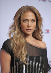 JLo wears some subtle gold shadow to softly accentuate her golden brown eyes.