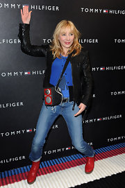 Julie poses for the camera in her on-trend leather jacket and funky ensemble.