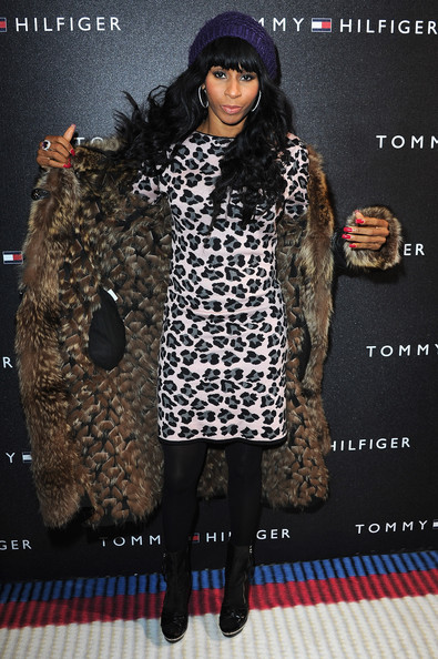Mia Frye donned black ankle boots over opaque tights. She paired the boots with an over the top fur coat.