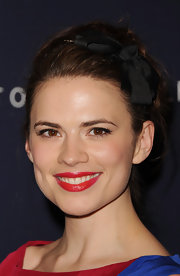 Hayley Atwell wore a ruby red lipstick and a touch of gloss at the Tommy Hilfiger flagship store launch.