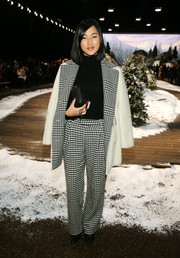 Nicole Warne continued the black-and-white print theme with a pair of checkered pants.
