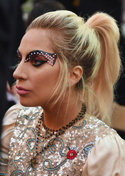 Lady Gaga sealed off her look with a rosary necklace by Virgins Saints & Angels.