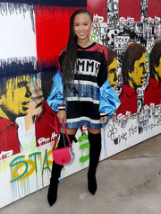 Serayah McNeill styled her look with black over-the-knee boots.
