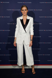 Olivia Palermo styled her suit with a chic pair of Gianvito Rossi ankle-tie sandals.