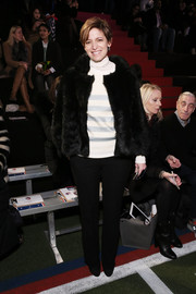 Cindi Leive was casual-glam in a black fur jacket, a turtleneck, and slacks at the Tommy Hilfiger fashion show.