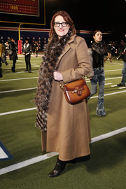Glenda Bailey kept warm with a beige wool coat, which she dolled up with a fur stole, when she attended the Tommy Hilfiger fashion show.