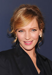 Uma Thurman wore her hair in a romantic updo with sexy side-swept bangs at the Tommy Hilfiger fall 2012 fashion show.