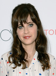 Zooey Deschanel attended the 'To Tommy, From Zooey' launch wearing a curly half-up 'do with wispy bangs.