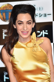 Amal Clooney attended the Tokyo premiere of 'Tomorrowland' wearing a teased half-up hairstyle.