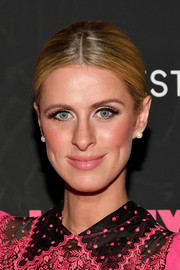 Nicky Hilton finished off her classy look with a pair of pearl studs.