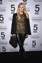 Nicky Hilton avoided an all-black theme by wearing an animal-print blouse under her jacket.