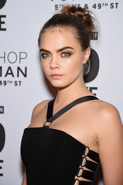 Cara Delevingne pulled her locks back into an edgy knot for the Topman New York City flagship opening dinner.