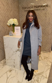 Ciara layered a light gray wool coat over a petrol-blue mini dress for the Topshop holiday season celebration.