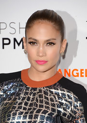 Jennifer Lopez added some pop to her beauty look with bright pink lips in a bubblegum candy shade.
